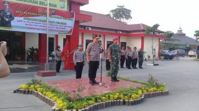 Kapolres Pelabuhan Belawan Pimpin Upacara Polri- TNI Pelepasan Tim Renang Dan Dayung