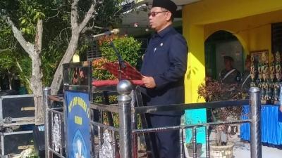AKBP Ikhwan Lubis SH.,MH Menghadiri Upacara Bendera Peringatan Hari Guru Nasional